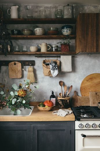 Our new DIY Kitchen, we wanted it to be imperfect in many ways, to have a mix of elements, a rough plaster look wall, rustic wooden shelves, textures, handmade ceramics and natural materials like elm worktops and plenty of beautiful and interesting storage solutions. We couldn't find any nice cooker hoods we liked, so we made our own and cladded it with wooden laths!