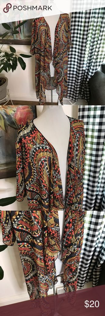 """LuLaRoe Shirley Kimono Sheer Boho Print Medium 8Y LuLaRoe Shirley Kimono. Size Medium. Long Duster Length. Gorgeous swirly boho print with coral, navy blue, light blue, gold, etc. Short Elbow Length Sleeves. Draped waterfall front. Perfect topper to elevate any simple outfit!    shoulder to bottom: approx 39.5"""" LuLaRoe Sweaters Cardigans"""