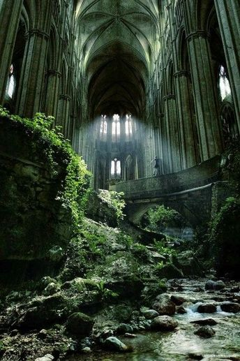 Spooky abandoned church with a river running through it