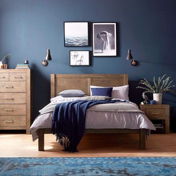 The Corniche bedroom range is crafted from dark American oak. Contrast with dark blue walls for a bold and beautiful look.