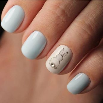 This accent nail has a bunny with a DIAMOND tail!
