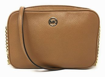 Michael Kors Fulton Leather Large East West Cross-body is crafted in beautiful pebbled leather with polished hardware. This larger size Fulton cross-body is lined in Michael Kors custom logo fabric and features a spacious open slip pocket on the back wall and 2 open slip pockets on the inner front wall. It has a fully zippered top closure and is accented with Michael Kors logo circular lozenge. It has a single leather and chain adjustable shoulder and cross-body strap. It measures appr..