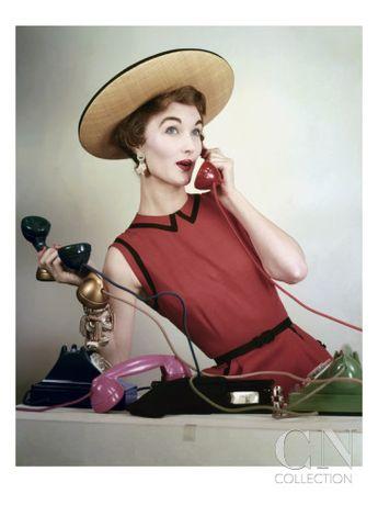 Evelyn Tripp Holding Telephones by Erwin Blumenfeld