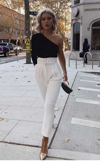 Black blouse and white pants with belt