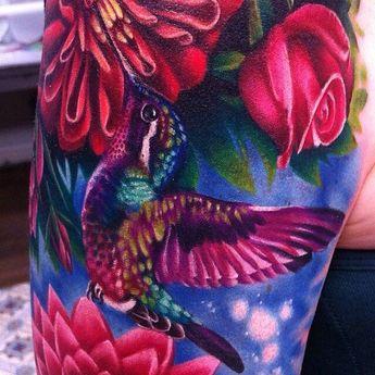 Tattoo idea humming bird with roses.