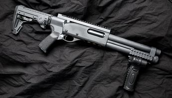 Remington 870 with Mesa Tactical High Tube Stock Adapter (a