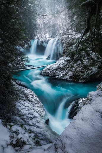 That amazingly blue water of Spirit Falls (WA) during a fresh dusting of snow (OC)[1335x2000] @rosssvhphoto