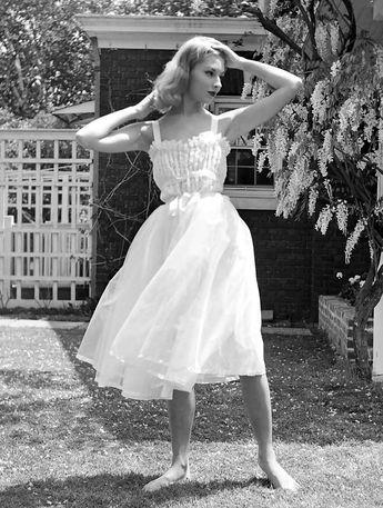"vintagefashionandbeauty: ""Vikki Dougan modeling a nightgown, photographed by Nina Leen, 1952. (x) """