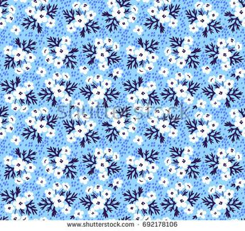 Floral pattern. Pretty flowers on light blue background. Printing with small white flowers. Ditsy print. Seamless vector texture. Spring bouquet.