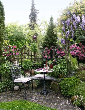 My inner landscape love the old iron fence that creates a subtle border giving a sense of privacy and a room.