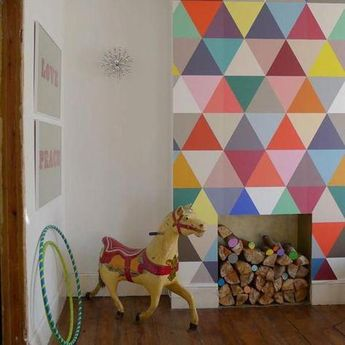 Geometry wallpaper, isosceles and right angle triangles create a contemporary design. Brights and pastels with a black and white contrasting stripe.A generic wa #Kidsroomideas