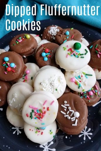 The perfect combination of textures and flavors, these chocolate dipped fluffernutter cookies are a great no bake treat. Peanut butter and marshmallow come together for the ultimate sweet and salty, crunchy and creamy cookies. #christmascookies #cookies #chocolate #peanutbutter #nobakecookies