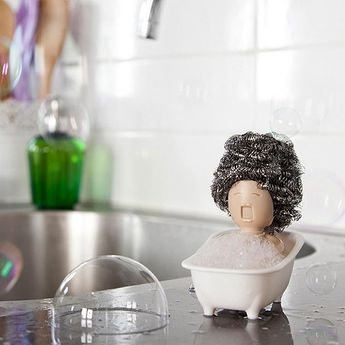 Diva Sponge Holder #inspireuplift   Add a fun and convenient scrubber holder next to your kitchen sink with the Diva Sponge Holder! She looks like a little lady singing in a bathtub. Whatever scrubber you place on her becomes her hair. In addition, the holder keeps your scrubber or sponge dry and looks cuter than just leaving it on the edge of the sink. You can also change her hairstyle by using a different scrubber. Similarly, the Diva Sponge Holder fits most types of scrubbers and sponges. It