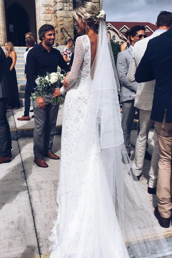 Lauren in our Mai gown, Gaia earring and Kinga veil | Grace Loves Lace