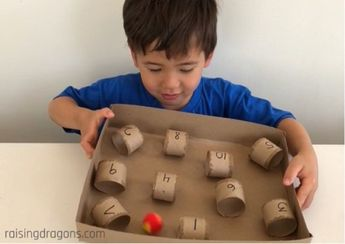 Paper Towel Roll  amp  Pom Pom Challenge   ages 3      Raising Dragons: The Paper Towel Roll & Pom Pom Challenge is easy to make and tons of fun for kids to play while building fine motor, counting and number recognition skills.