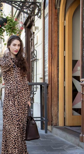 e924cc79139d Beautiful Slovenian Fashion Blogger Veronika Lipar of Brunette from Wall  dressed in long leopard dress from