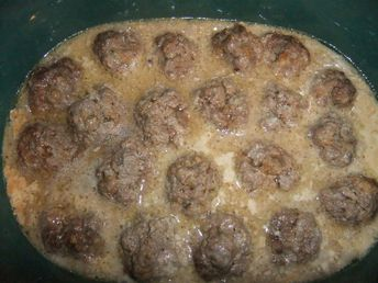 creamy crockpot meatballs With no unhealthy condensed cream of whatever soup!  Will use the regular sour cream.  Yummy!  Next time will  decrease flour to 1/4 cp.