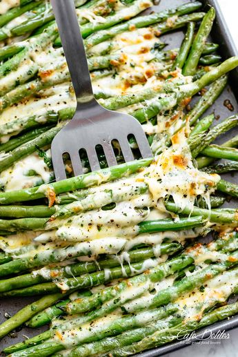 In a small bowl mix together olive oil, parmesan, garlic, salt and pepper. Drizzle the oil mixture over the green beans and toss to evenly coat.