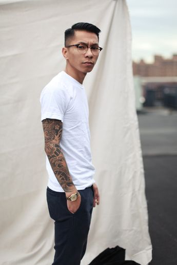 hair, glasses, tatted sleeve, the fit of the plain white t and pants. i guess basically everything.