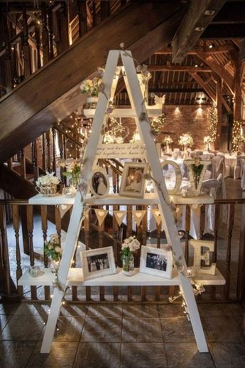 2019 Top 15 Must See Rustic Wedding Ideas---wooden ladder photo display with greenery and flowers, barn weddings, wedding decoration ideas