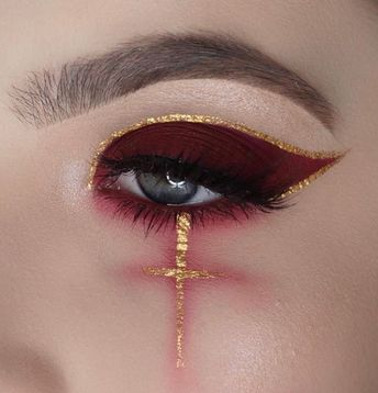 Image discovered by Lindy. Find images and videos about makeup, red and gold on We Heart It - the app to get lost in what you love.
