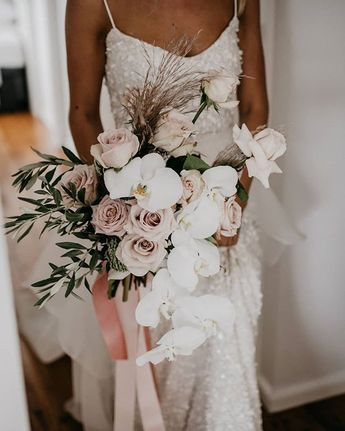 Ahhhhh...can we have a bunch of these delivered every week?! Tegans beautiful bouquet by @e.m.floral.design beautifully compliments her LUXE Anya gown. #ANYAgown #KWHLuxe #weddingflowers Photographed by @JasonCorrotophoto