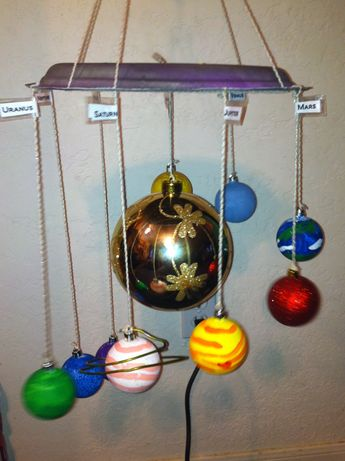 5th grade science project. Solar system made out of plastic Christmas ornaments, string and a paper plate. It was inexpensive, easy and fun to make! My daughter painted the planets all by herself!