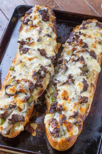 Philly Cheesesteak Cheesy Bread is cheesy and crunchy and full of delicious cheese steak flavors including ribeye steak, green bell peppers, onions and mushrooms.   #philly #phillycheesesteak #cheesybread #cheese #cheesebread #steak #cheesesteak #dinnerthendessert #appetizer #sides #party #partyfood