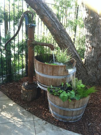 We took an old water pump and 2 half wine barrels to create this cool rustic fountain!
