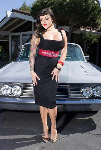 My dad was an old school hot rod guy and he was also a sign painter. He also did pinstriping on all his cars and everything else in my house! I made this dress based on his style of pinstriping. This sexy wiggle dress features black stretch sateen fabric with a contrast panel in red with hot rod pinstriping embroidery #hotsexytattos