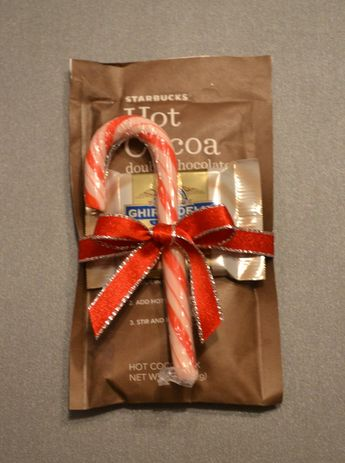 Cute office gift: Hot Cocoa packet, white chocolate, and a peppermint stick. Easy!!