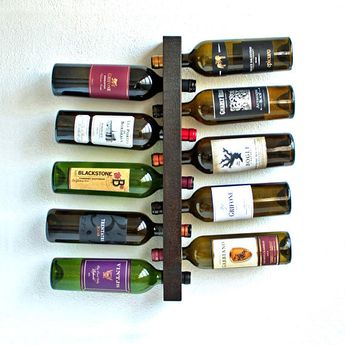 Wall Wine Rack - 10 Bottle Holder Storage Floating Display This Wood Wall Mounted Vertical Wine Rack holds 10 FULL bottles of wine safely and securely. This floating shelf type wine rack is made of one solid piece of hand selected Western Cedar that is stained in a beautiful and rich