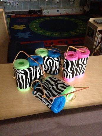 Binoculars made with pool noodles, duct tape and leather shoe laces.