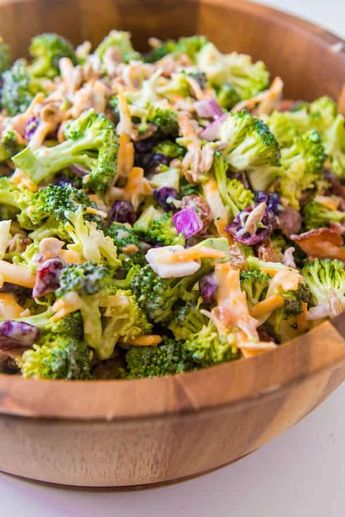 Everyone's favorite quick and easy side for our BEST broccoli salad recipe that's perfect for potlucks and BBQs. Plus it has bacon in it! golden raisins, craisins, sunflower seeds, bacon, frozen peas, red onion