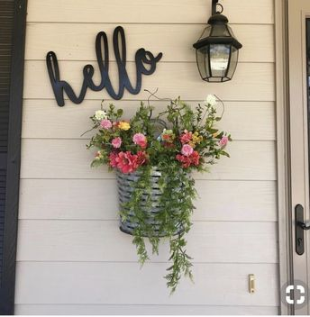 Maybe add a little hanging basket with some fake flowers... ?