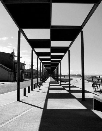 I like this photos and it's use of shadow because of it's use of leading lines, the shadow also has a sort of checker pattern that is very appealing and creative.