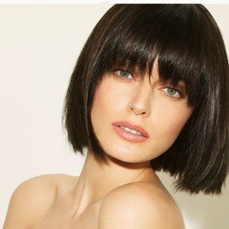 Short blunt bob with heavy front bangs. Very chic and modern. Chin length. Short hair. Hairstyle. Haircut. Brunette. Classic.: