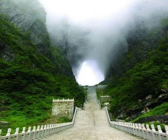 """This is called """"Gate to Heaven""""  About 8KM from downtown of Zhangjiajie lies the Tianmen Mountain, also known as Heaven Gate Mountain.  This beautiful site is quite a journey to get to through a 7 mile hike. The Chinese people believe that this is the Closest Earth Landmark To God.  For those unable to trek, they have a cable car that is considered the longest cable ride in the world- A distance of 7455m Also on the top is a 500 year old Temple."""