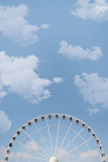 White Ferris Wheel Under White Cloudy Blue Sky