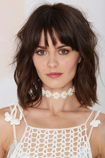 """Feelin' floral? The Daised and Confused Choker is a white and yellow embroidered daisy """"chain"""" and features adjustable chain closure with lobster clasp.Team it up with everything from cutoffs to mini dresses."""