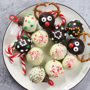 These Oreo Truffles for a holiday classic with these adorable reindeer, ugly sweater, peppermint and ornament designs. Perfect for holiday parties, DIY gift ideas and sharing with family and friends. A great kids craft activity.