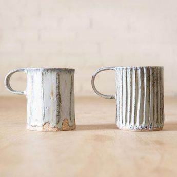 These hand-formed and carved stoneware mugs are handmade in Los Angeles by ceramicist Beth Katz of Mt. Washington Pottery. Beautiful and tactile with a soft matte lavender glaze, they're available in two different carving styles, Column and Facet. Column is characterized by slim lines, while Facet is made of wider vert