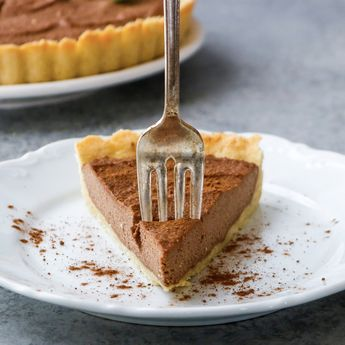 CHOCOLATE SILK PIE Makes 8 servings Crust: 1½ cups almond flour 1 large pasture-raised egg, room temperature 1/4 cup melted ghee 1/4 tsp. sea salt  Filling: 2 cups raw cashews, soaked in water 6 hours 1/2 cup unsweetened canned coconut milk 2 Tbsp. melted coconut oil 3 Tbsp. pure maple syrup 2 Tbsp. raw cacao powder or Cacao Bliss 2 tsp. vanilla extract Click the photo for the full recipe