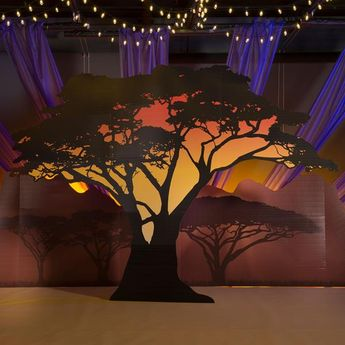 Use our Wild Safari Dreams Large Tree Silhouette for your jungle or safari themed party! This free-standing prop features a beautiful tree image accented with the colors of a sunset printed on one side.