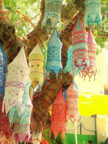 My Bohemian Home ~ Outdoor Spaces Indian cloth lanterns hanging from a tree.