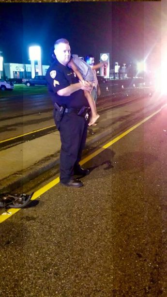 Photo Of Louisiana Police Officer Comforting Child After Car Crash Goes Viral (Photos)