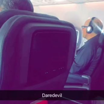 This guy was sitting next to me on the plane like this, so I made this video because obviously I had to otherwise what kind of piece of shit would I be? #daredevil (turn sound on) @daredevil