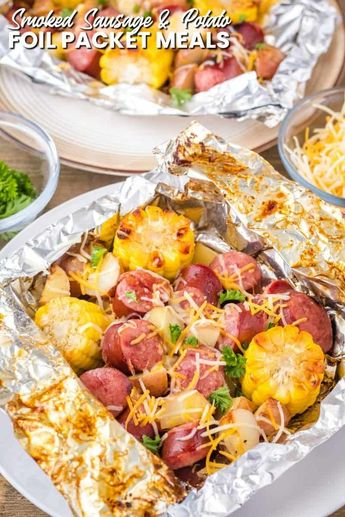 This Smoked Sausage and Potatoes Foil Packet Meal is a simple recipe that's ready in under 30 minutes with practically no cleanup! #BreadBoozeBacon #grilled #foilpacket #cookout #tailgating