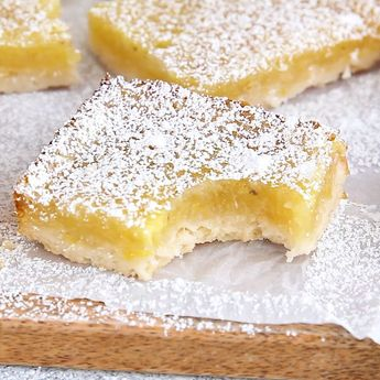 Vegan lemon bars are tart, sweet and a perfect vegan dessert, using all whole ingredients, no tofu and no cashews! Easy and with a vegan shortbread crust. #vegan #dessert #lemon #recipe| heartofabaker.com