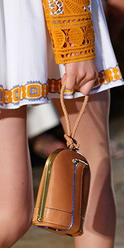 The dome clutch: beautiful vachetta leather edged with opalescent paint #toryburch #toryburchss16 #nyfw
